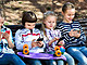 Group of children posing  with mobile devices